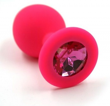 Розовая силиконовая анальная пробка с тёмно-розовым кристаллом - 7 см.